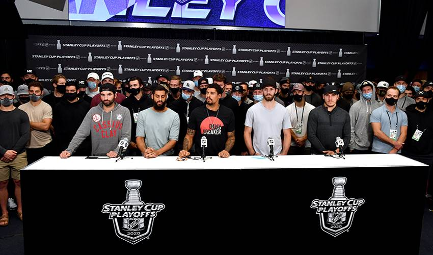 Players stand in solidarity against racial injustice