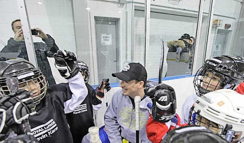 Players Hit 100th Surprise Practice Visit