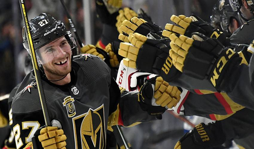 Theodore ends holdout, agrees to 7-year deal with Vegas