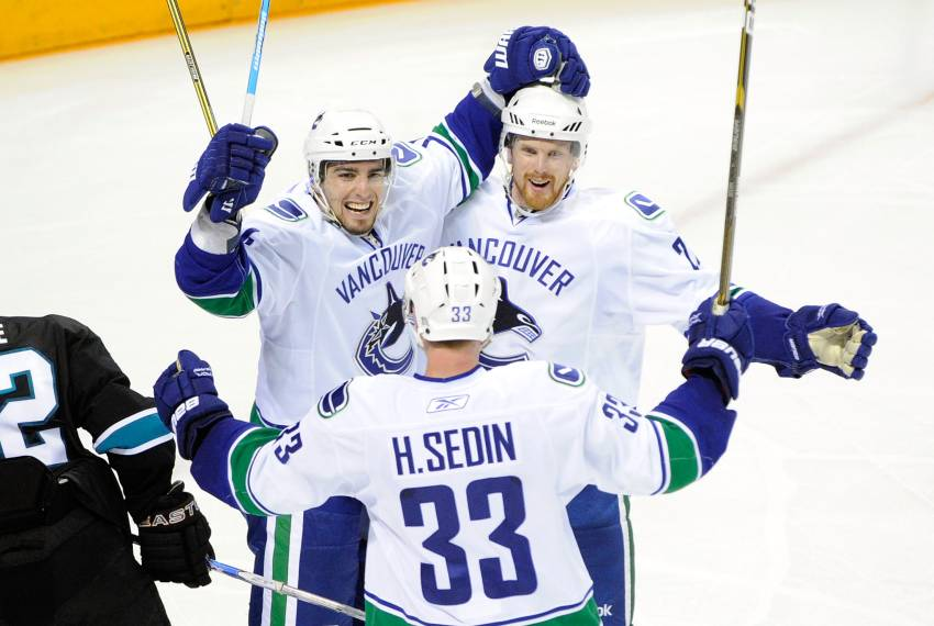 SAN JOSE, CA - MAY 22: (L-R) Alex Burrows #14, Henrik Sedin #33 and Daniel Sedin #22 of the Vancouver Canucks celebrate Burrows' goal in the third period against the San Jose Sharks in Game Four of the Western Conference Finals during the 2011 Stanley Cup Playoffs at HP Pavilion on May 22, 2011 in San Jose, California. The Canucks defeated the Sharks 4-2. (Photo by Thearon W. Henderson/Getty Images)
