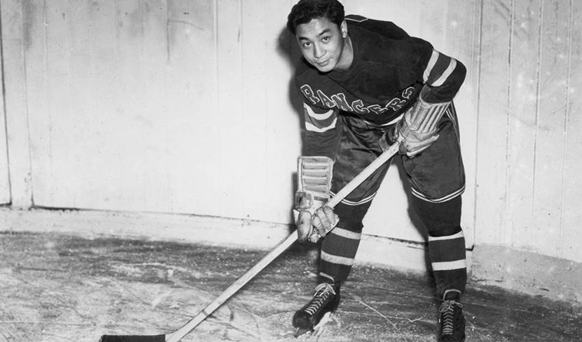Larry Kwong, first player of Asian heritage to appear in the NHL, dies at age 94