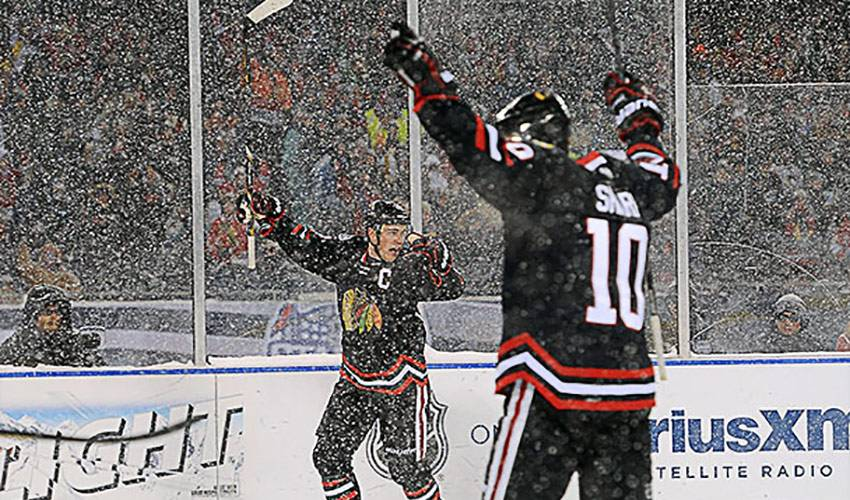 Toews and Sharp Jumpstart the 'Hawks at Soldier Field