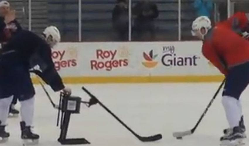 Washington Capitals Players Practice Against Robot
